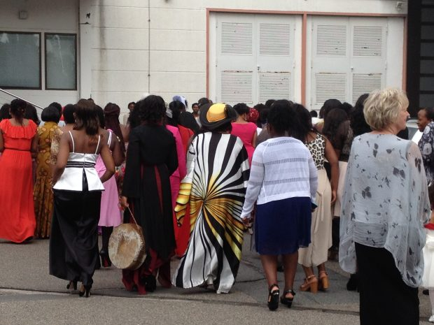 African women going to a worship